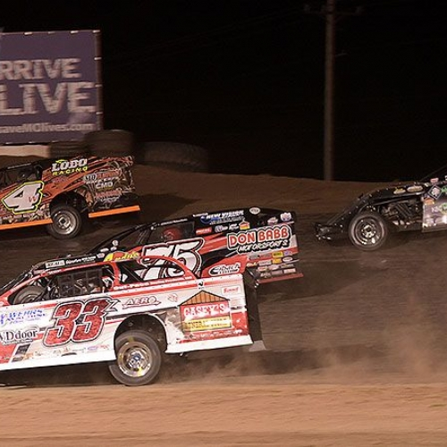 Zack VanderBeek (33z), Terry Phillips (75), Tyler Wolff (4w) and Stormy Scott (2s) race for position in the main event during the 9th Annual USMTS Missouri Meltdown at the I-35 Speedway in Winston, Mo., on Saturday, April 22, 2017.