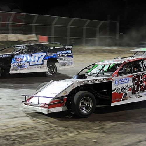 Cade Dillard (97) and Zack VanderBeek (33z) during a restart in the main event at the 6th Annual Summit Showdown in the Playground at the 81 Speedway in Park City, Kan., on Wednesday, June 7, 2017.