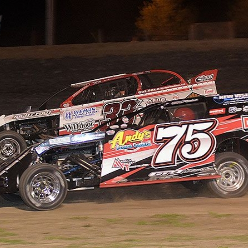 Side-by-side action between Terry Phillips (75) and Zack VanderBeek (33z) during the 9th Annual USMTS Missouri Meltdown at the I-35 Speedway in Winston, Mo., on Saturday, April 22, 2017.