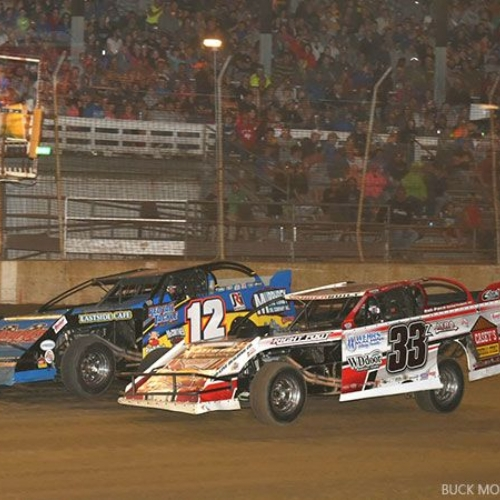 With two laps to go in the main event, Zack VanderBeek (33z) tried to pass the leader, Jason Hughes (12), but had to settle for second place at the 10th Annual USMTS Nordic Nationals at the Upper Iowa Speedway in Decorah, Iowa, on Sunday, May 28, 2017.