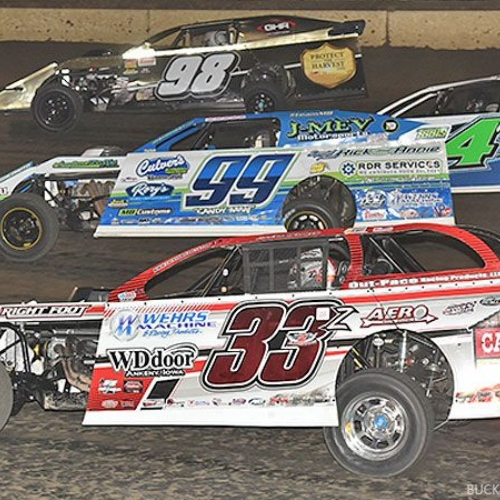 Four-wide race between Zack VanderBeek (33z), Josh Angst (99), Dereck Ramirez (4r) and John Allen (98) during the 19th Annual Featherlite Fall Jamboree at the Deer Creek Speedway in Spring Valley, Minn., on Friday, Sept. 22, 2017.