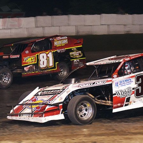 Zack VanderBeek (33z) and Mike Densberger (81) battle for position during the main event at the 3rd Annual USMTS Southern Kansas Nationals at the Caney Valley Speedway in Caney, Kan., on Tuesday, June 6, 2017.