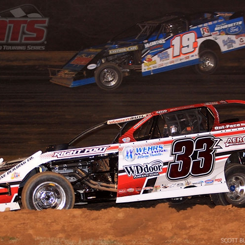 Battling with Ryan Gustin in the USMTS main event at the Ark-La-Tex Speedway in Vivian, La., on Friday, March 3, 2017.