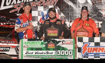 Zack celebrates with his father, Jim, and USMTS flagman Ryne Staley after winning Round #1 of the USMTS Badgerland Summer Shootout presented by Prestige Custom Cabinetry at the Luxemburg Speedway in Luxemburg, Wis., on Tuesday, July 11, 2017.