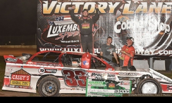 Zack celebrates after winning Round #1 of the USMTS Badgerland Summer Shootout presented by Prestige Custom Cabinetry at the Luxemburg Speedway in Luxemburg, Wis., on Tuesday, July 11, 2017.