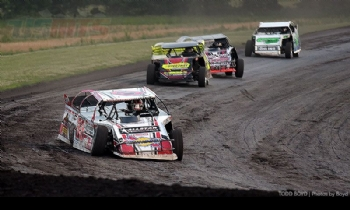 Zack VanderBeek leads a pack of cars during heat race action at the 7th Annual USMTS Malvern Bank Duals at the Adams County Speedway in Corning, Iowa, on Saturday, June 10, 2017.